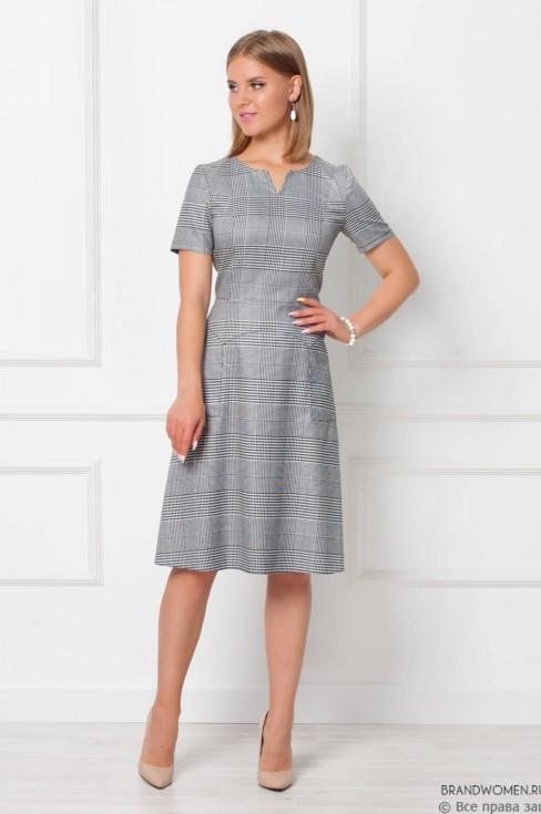 Платье-миди с необычным вырезом и карманами