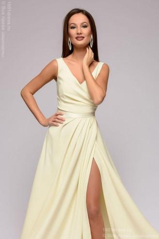 Платье в пол с разрезом на юбке и глубоким декольте